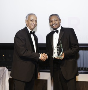 PROFESSOR SIR SABARATNAM ARULKUMARAN PRESENTED THE HEALTH AND EDUCATION AWARD BY MR MARTIN FORDE QC