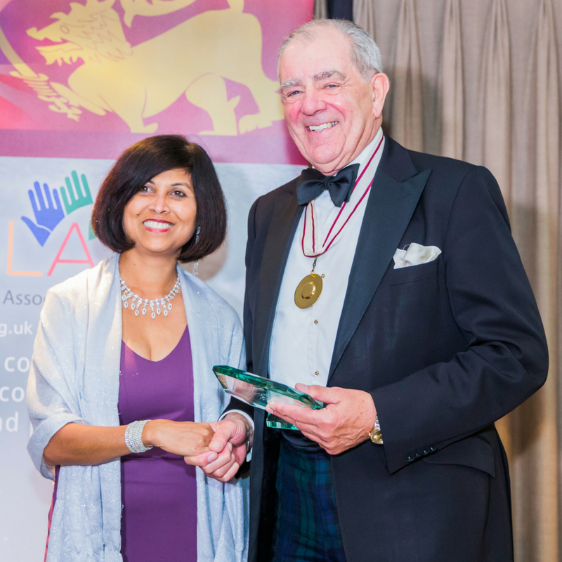 Colonel Geoffrey Godbold, Deputy Lord Lieutenant, presenting to Mrs Ajantha Tenakoon on behalf of Aswini Weeratne QC.