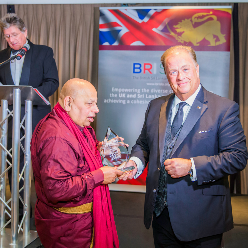 Mr Ian Richards presenting to Venerable Galayaye Piyadassi MBE.